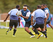 Nemia Soqeta avoids a tackle during the Fiji Training Session in preparation for the Rugby World Cup at London Irish RFC, Sunbury-On-Thames, United Kingdom on 14 September 2015. Photo by Ian Muir. during the Fiji Training Session in preparation for the Rugby World Cup at London Irish RFC, Sunbury-On-Thames, United Kingdom on 14 September 2015. Photo by Ian Muir.