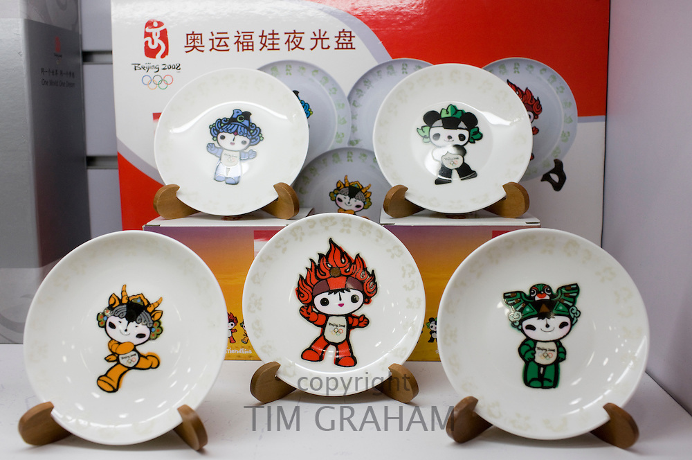 2008 Olympic Games official Fuwa mascot character plates in souvenir shop, Wangfujing Street, Beijing, China