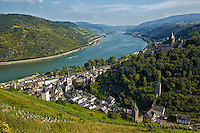 Romantic Rhine view of Stahleck Castle, Rhine River, and rolling hills, Bacharach, Germany.