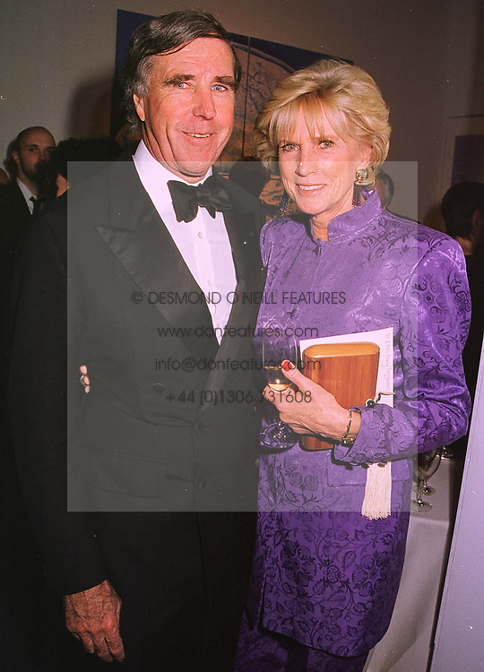 MR & MRS HARRY FITZGIBBONS at an exhibition in London on 26th October 1998.MLF 49