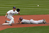 Oklahoma's Aaron Reza (R) steals second base, as Kansas State second basemen Eddie Vasquez (L) takes the throw at Tointon Stadium in  Manhattan, Kansas, April 22, 2007.  Oklahoma defeated Kansas State 12-4.