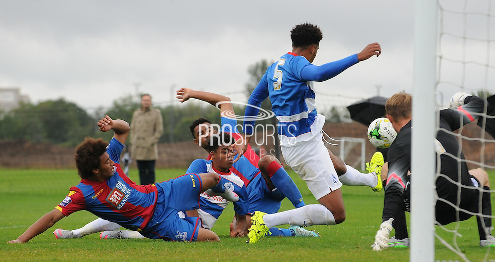 Keshi Anderson and Luke Croll try in vain to bundle the ball home during the U21 Professional Development League match between U21 QPR and U21 Crystal Palace at the Loftus Road Stadium, London, England on 31 August 2015. Photo by Michael Hulf.