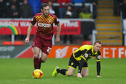 Bradford City defender Rory McArdle wins the ball from Burton Albion forward Stuart Beavon during the Sky Bet League 1 match between Burton Albion and Bradford City at the Pirelli Stadium, Burton upon Trent, England on 6 February 2016. Photo by Aaron Lupton.