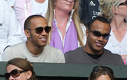 29.06.2011, Wimbledon, London, GBR, ATP World Tour, Wimbledon Tennis Championships, im Bild Formula one race driver Lewis Hamilton and half-brother Nicolas during the Gentlemen's Singles Quarter-Final match on day nine of the Wimbledon Lawn Tennis Championships at the All England Lawn Tennis and Croquet Club. EXPA Pictures © 2011, PhotoCredit: EXPA/ Propaganda/ David Rawcliffe +++++ ATTENTION - OUT OF ENGLAND/UK +++++