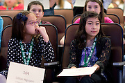 Lillian Nguyen, left, and Jenna Lapurga, right,  wait for their turns to spell a word during the during the Southeast Ohio Regional Spelling Bee Saturday, March 16, 2013. The Regional Spelling Bee was sponsored by Ohio University's Scripps College of Communication and held in Margaret M. Walter Hall on OU's main campus.