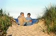 Senior couple enjoys quality time on a beach dune, Nauset Beach, Cape Cod, MA