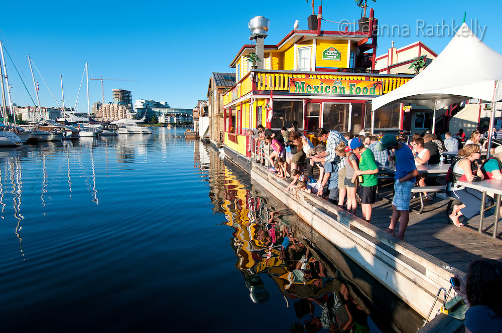 Fisherman's Wharf in Victoria, BC, is home to dozens of colorful houseboats and is a favorite tourist spot, especially with feeding fish to the ocean seals.