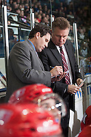 KELOWNA, CANADA - MARCH 7: Don Nachbaur, head coach confers with Scott Burt, assistant coach of the Spokane Chiefs on the bench against the Kelowna Rockets on March 7, 2015 at Prospera Place in Kelowna, British Columbia, Canada.  (Photo by Marissa Baecker/Shoot the Breeze)  *** Local Caption *** Don Nachbaur; Scott Burt;