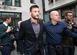 © Licensed to London News Pictures. 12/09/2018. London, UK. Tottenham Hotspur Captain and French international goalkeeper Hugo Lloris  (2L) leaves Westminster Magistrates Court after pleading guilty to drink driving after he was stopped by police on 24 August. Photo credit: Peter Macdiarmid/LNP