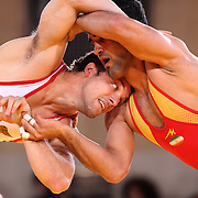 Reece Humphrey, USA, (blue) in action against Masoud Esmailpour Jouybarii, Iran, as wrestlers from USA, Iran and Russia compete at Grand Central Terminal as part of the Beat the Streets Gala. Billed ?The Rumble On The Rails,? the international wrestling event showcased competition as part of World Wrestling Month. Vanderbilt Hall, Grand Central Station, Manhattan,New York. USA. 15th May 2013. Photo Tim Clayton