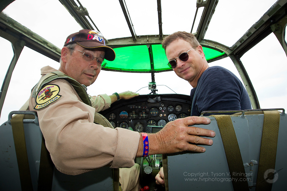 Larry Kelley and Gary Sinise prepare to taxi B-25 Panchito leading the Veteran's Parade...Disabled American Veterans Parade activities involving Vietnam Veteran and triple-amputee, Jim Sursely, B-25 'Panchito' owner and pilot, Larry Kelley and actor Gary Sinise.