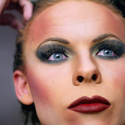 Miss Helyn Ducati, Jesse Sutton, finishes applying make-up as he was getting ready for the Masquerade Saturday evening at the Radisson Ballroom in downtown Rochester. Ducati is Miss Gay Southeast Minnesota 2004. (Rochester Post-Bulletin,Christina Paolucci)