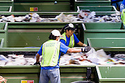 12 MARCH 2007 -- PHOENIX, AZ: Hudson Baylor employees sort paper products at the new recycling center in the city of Phoenix, AZ. The center opened in February 2007 and is the most modern recyclables processing center in the US. The center is operated by Hudson Baylor Corporation and processes about 1000 tonnes of recyclables a week.  Photo by Jack Kurtz/ZUMA Press