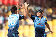 Marchant de Lange of the Titans is congratulated by Heino Kuhn of the Titans for getting Lendl Simmons of Trinidad &amp; Tobago wicket during match 16 of the Karbonn Smart Champions League T20 (CLT20) 2013  between The Titans and Trinidad and Tobago held at the Sardar Patel Stadium, Ahmedabad on the 30th September 2013<br /> <br /> Photo by Shaun Roy-CLT20-SPORTZPICS  <br /> <br /> Use of this image is subject to the terms and conditions as outlined by the CLT20. These terms can be found by following this link:<br /> <br /> http://sportzpics.photoshelter.com/image/I0000NmDchxxGVv4