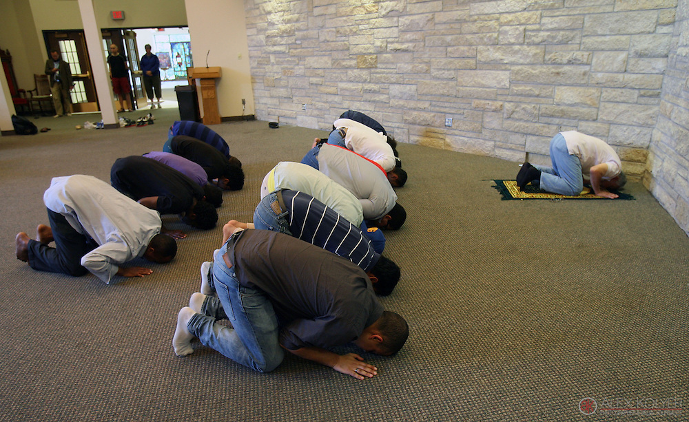 9/13/13--Winona<br /> Men pray at Central Lutheran Church Friday, Sept. 13, 2013, after the Islamic Center of Winona was destroyed by a fire earlier in the day. The Lutheran church offered a space for the Islamic Center members to hold their Friday prayer services. (Photo for MPR News by Alex Kolyer)