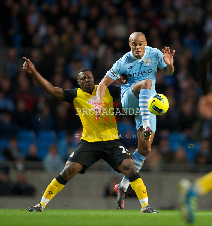 MANCHESTER, ENGLAND - Saturday, February 25, 2012: Manchester City's Vincent Kompany in action against Blackburn Rovers' Yakubu during the Premiership match at City of Manchester Stadium. (Pic by David Rawcliffe/Propaganda)