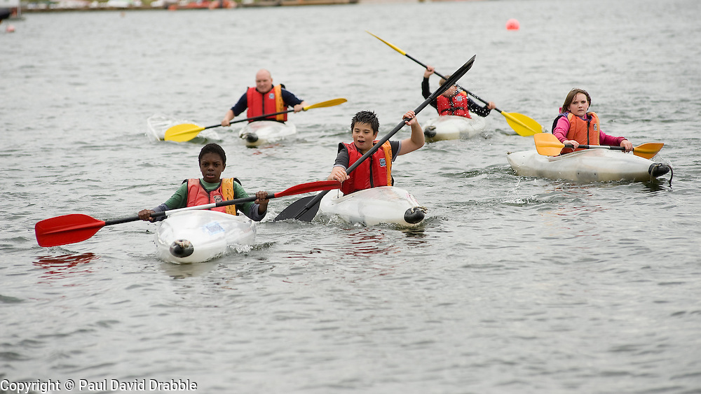 Adam Bates (second from left back) Guinness Northern Counties Youth Coordinator,  with Kids from the Guinness Northern Counties Briary Close housing scheme in Wakefield Kayaking Pugneys Country Park on Thursday  26 August 2010 .Images © Paul David Drabble..