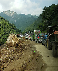 CHITWAN, Sept. 12, 2016 (Xinhua) -- Heavy vehicles line up in a traffic jam on a landslide-hit road of Prithvi Highway in Chitwan, Nepal, Sept. 11, 2016. The road often encounters landslides during monsoon season, causing road blockade for long time. Vehicles even face accidents in such highways in Nepal. (Xinhua/Sunil Sharma).****Authorized by ytfs* (Credit Image: © Sunil Sharma/Xinhua via ZUMA Wire)