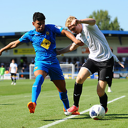 TELFORD COPYRIGHT MIKE SHERIDAN Kaiman Anderson (formerly of AFC Telford and Shrewsbury) holds off Chris Lait of Telford during the National League North fixture between AFC Telford United and Leamington AFC at the New Bucks Head on Monday, August 26, 2019<br /> <br /> Picture credit: Mike Sheridan<br /> <br /> MS201920-005