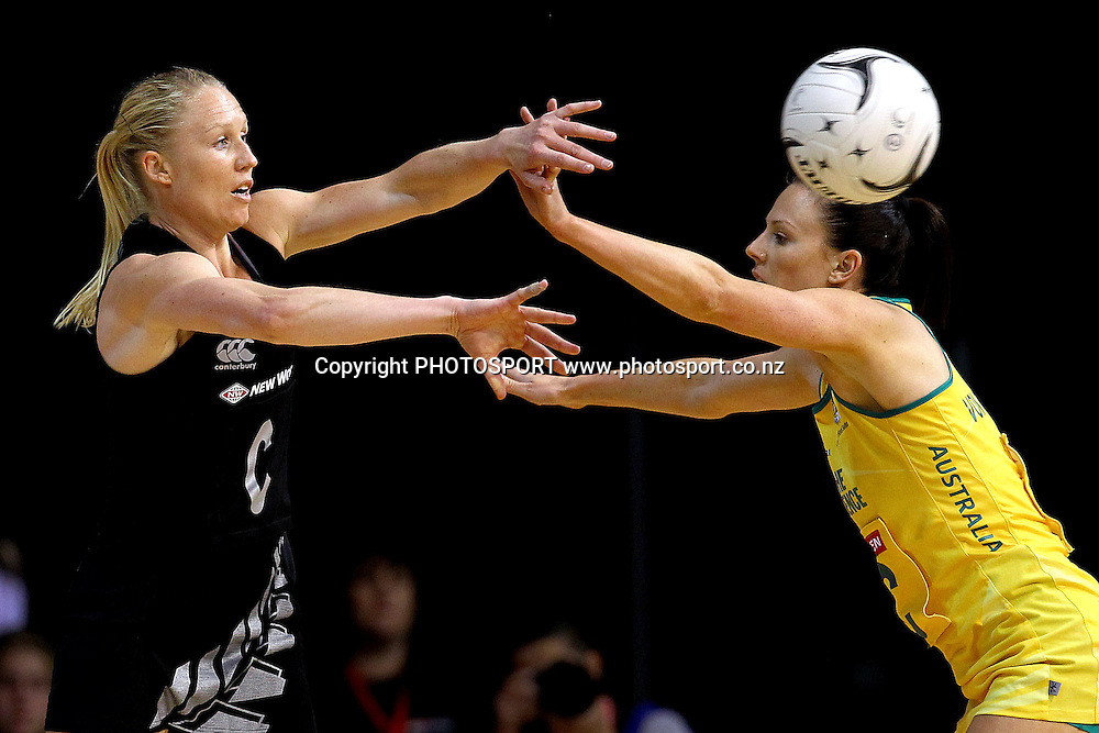 Silver Fern's Laura Langman makes a pass through Australia's Natalie von Bertouch. New World Quad Series, New Zealand Silver Ferns v Australian Diamonds at Claudelands Arena, Hamilton, New Zealand. Thursday 1st November 2012. Photo: Anthony Au-Yeung / photosport.co.nz