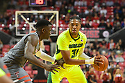 LUBBOCK, TX - DECEMBER 29: Terry Maston #31 of the Baylor Bears handles the ball against Norense Odiase #32 of the Texas Tech Red Raiders during the game on December 29, 2017 at United Supermarket Arena in Lubbock, Texas. Texas Tech defeated Baylor 77-53. (Photo by John Weast/Getty Images) *** Local Caption *** Terry Maston;Norense Odiase