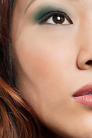 Cropped image of beautiful Chinese woman with makeup looking away