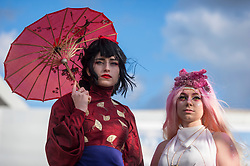 © Licensed to London News Pictures. 26/10/2018. LONDON, UK. A couple dressed as anime characters join cosplayers from all over the world on the opening day of the bi-annual MCM Comic Con event at the Excel Centre in Docklands.  The event celebrates popular culture such as video, games, manga and anime providing many attendees with the opportunity to dress up as their favourite characters.  Photo credit: Stephen Chung/LNP