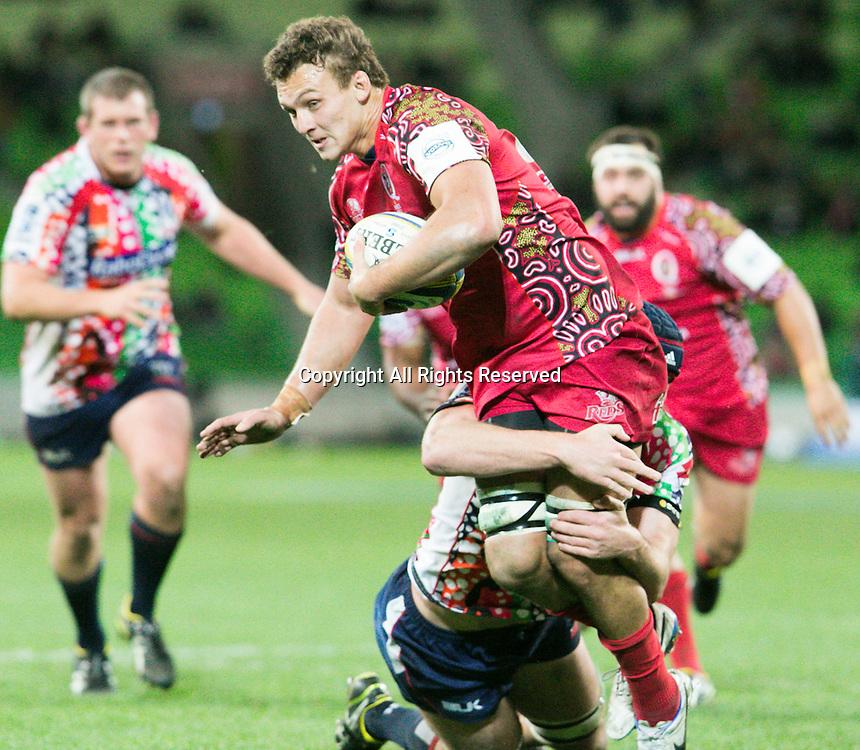 27.06.2014.  Melbourne, Australia.  Super 15 Rugby Union, Melbourne Rebels versus  Queensland Reds. Jake Schatz of the Reds gets tackled.