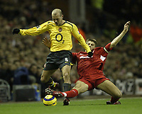 Photo: Aidan Ellis.<br /> Liverpool v Arsenal. The Barclays Premiership. 14/02/2006.<br /> Liverpool's Steven Gerrard challenges Arsenal's freddie Ljunberg