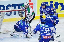 Jure Kralj (HDD Tilia Olimpija, #18) vs Robert Kristan (KHL Medvescak Zagreb, #33) during ice-hockey match between KHL Medvescak Zagreb and HDD Tilia Olimpija in 42nd Round of EBEL league, on Januar 25, 2011 at Arena Zagreb, Zagreb, Croatia. (Photo By Matic Klansek Velej / Sportida.com)