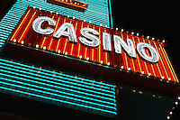 Neon casino sign at night low angle view
