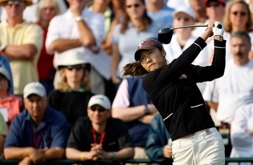 Candie Kung of Chinese Taipei hits her tee shot on the 1st hole during the third round of the US Women's Open Golf Championship at Newport Country Club in Newport Rhode Island, Sunday 2 July 2006