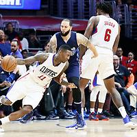 23 December 2016: LA Clippers guard Jamal Crawford (11) drives past Dallas Mavericks guard Deron Williams (8) on a screen set by LA Clippers center DeAndre Jordan (6) during the Dallas Mavericks 90-88 victory over the LA Clippers, at the Staples Center, Los Angeles, California, USA.
