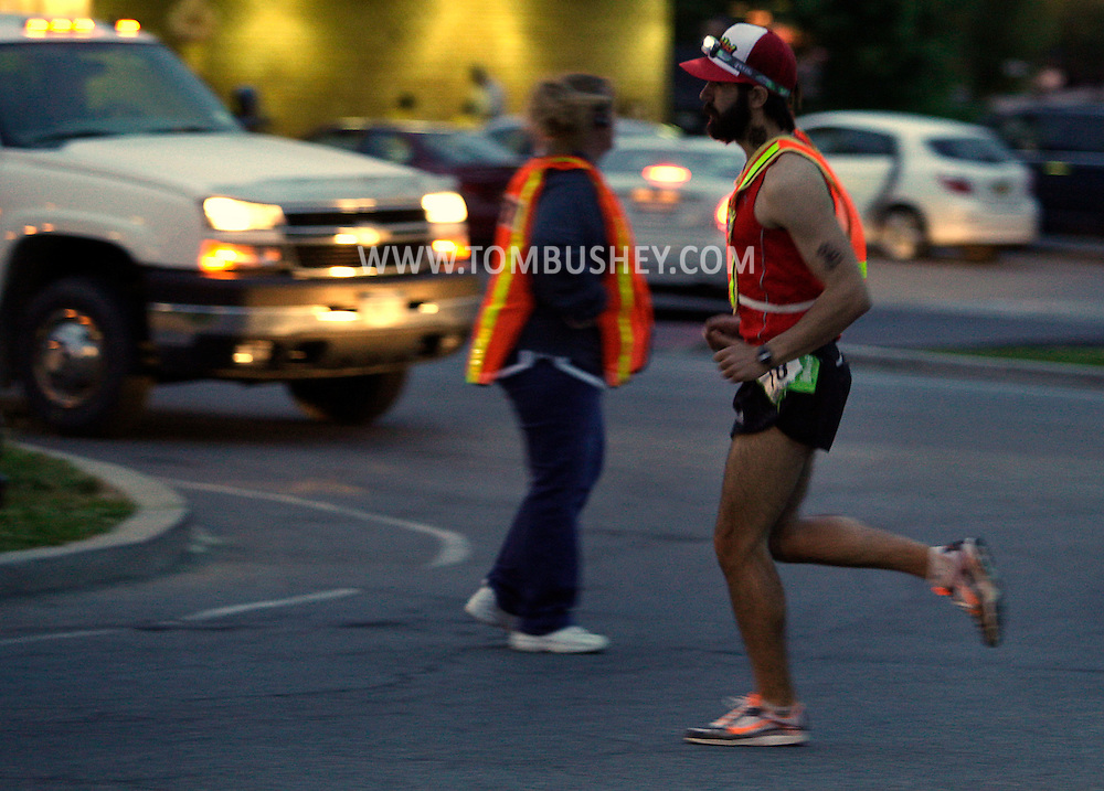 A runner turns onto Route 52 in Pine Bush during the Ragnar Relay on Friday evening, May 13, 2011.