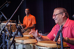 Arturo Sandoval with UVI student drummer Howard Peters.  Cuban Jazz trumpeter, pianist, and composer Arturo Sandoval plays alongside local high school and college musicians and answers questions about his life, inspiration, and performances at Reichhold Center for the Arts.  St. Thomas, USVI.  2 October 2015.  © Aisha-Zakiya Boyd