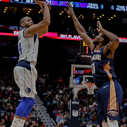 Dec 29, 2017; New Orleans, LA, USA; Dallas Mavericks guard Devin Harris (34) shoots over New Orleans Pelicans guard Jrue Holiday (11) during the first quarter at the Smoothie King Center. Mandatory Credit: Derick E. Hingle-USA TODAY Sports