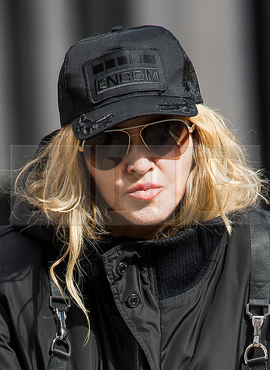©  London News Pictures. 10/04/2016. London, UK.  Singer MADONNA wearing what appears to be a gum shield while leaving her home in central London on her bike. Madonna was reunited with her son Rocco following a recent court battle over his custody with Madonna's former husband Guy Ritchie. Photo credit: Ben Cawthra/LNP
