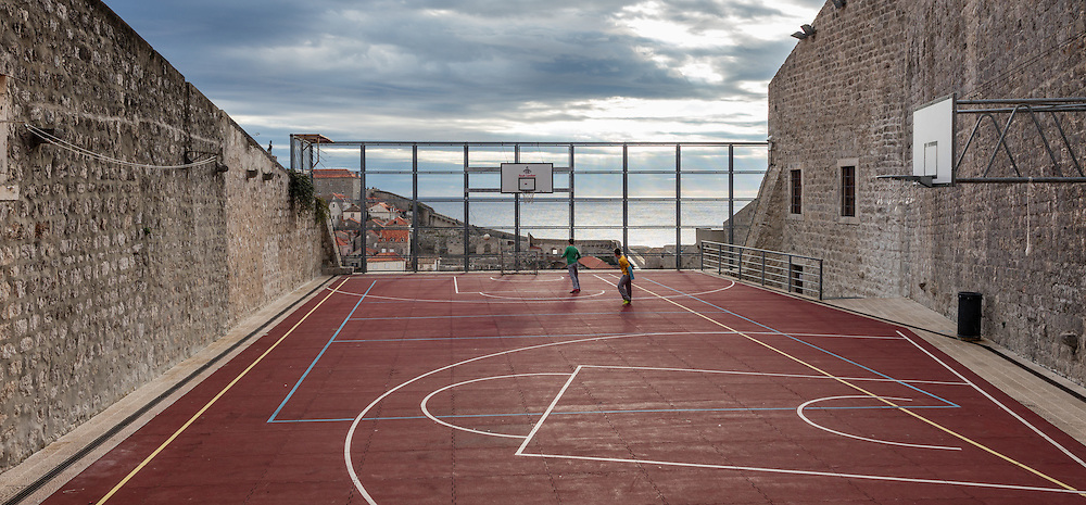 Two young boys play soccer in this uniquely located playground found within the old city walls of Dubrovnik.