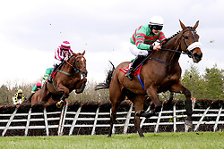 Magic Of Light (right) ridden by jockey Ryan Treacy jumps the last on the way to winning the Martinstown Opportunity Series Final Handicap Hurdle during day two of the Punchestown Festival in Naas, Co. Kildare.