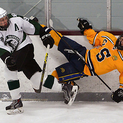 Staff photos by Tom Kelly IV<br /> Ridley's Nick Woods (97) takes down Springfield's Tom Coll (12) during the Springfield vs Ridley ice hockey game at Ice Works in Aston, Thursday night.