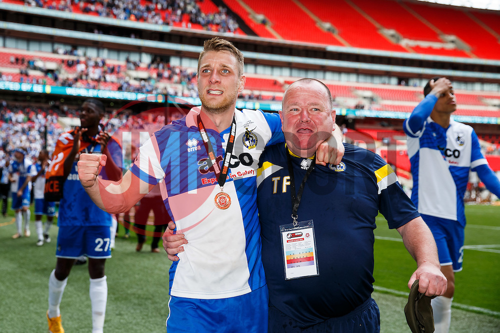 Lee Brown celebrates with the kit man after Bristol Rovers win the match on penalties  to secure promotion to the Football League 2 - Photo mandatory by-line: Rogan Thomson/JMP - 07966 386802 - 17/05/2015 - SPORT - FOOTBALL - London, England - Wembley Stadium - Bristol Rovers v Frimsby Town - Vanarama Conference Premier Play-off Final.