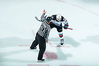 KELOWNA, BC - JANUARY 24: Ethan Ernst #19 of the Kelowna Rockets lines up as linesman Michael McGowan calls for the face-off against the Seattle Thunderbirds at Prospera Place on January 24, 2020 in Kelowna, Canada. (Photo by Marissa Baecker/Shoot the Breeze)