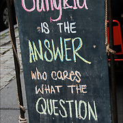 "Blackboard humorous  outdoor restaurant sign. ""Sangria is the Answer who cares what the question is """