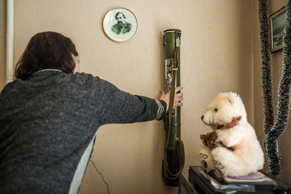 GORLOVKA, UKRAINE - JANUARY 31, 2015: Ira, a rebel fighter, reaches for an anti-tank weapon inside a house used as a rebel base behind front-line positions in Gorlovka, Ukraine. Fighting in Ukraine has intensified over the last week, with rebels declaring the end of a September ceasefire. CREDIT: Brendan Hoffman for The New York Times