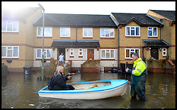 Resident's in flooded  Egham, Surrey,  United Kingdom,  use their own boats to move out of their homes as floods hit Britain, Thursday, 13th February 2014. Picture by Andrew Parsons / i-Images