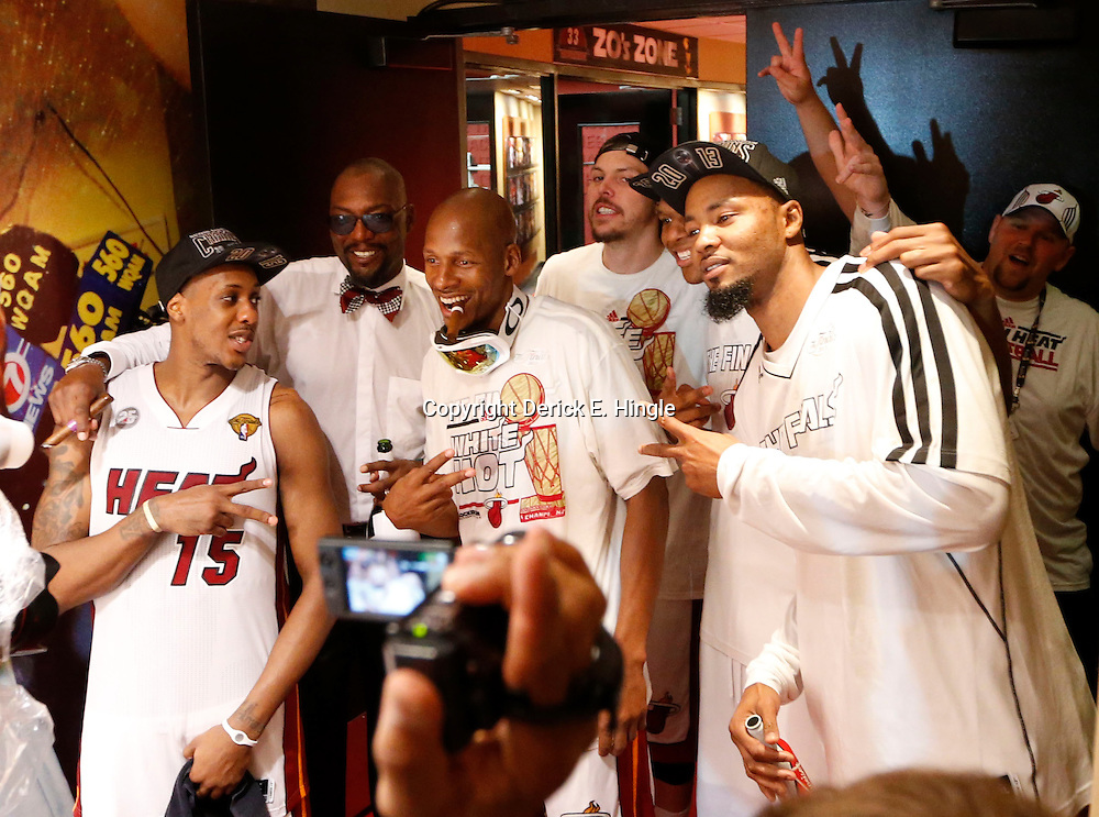 Jun 20, 2013; Miami, FL, USA; Miami Heat point guard Mario Chalmers (15), Ray Allen and Rashard Lewis celebrate int he locker room following game seven in the 2013 NBA Finals at American Airlines Arena. Miami defeated San Antonio 95-88 to win the NBA Championship. Mandatory Credit: Derick E. Hingle-USA TODAY Sports