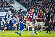 Frederic Guilbert (Aston Villa) & Trezeguet (Aston Villa) with the ball looked by Aaron Mooy (Brighton) during the Premier League match between Brighton and Hove Albion and Aston Villa at the American Express Community Stadium, Brighton and Hove, England on 18 January 2020.