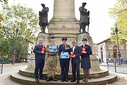 © Licensed to London News Pictures. 31/10/2017. London, UK.  (L to R) Andy Kent (TFL), Mark Quickfall (Household Recovery Mounted Regiment), Eric Reeve (TFL), Mayor of London, Sadiq Khan and Sophia Hickinson (RAF) at the War Memorial outside Euston Station in support of the Royal British Legion's London Poppy Day campaign.  The annual London Poppy Day Appeal sees 2,500 service personnel, veterans and volunteers trying to raise GBP1m in a single day.  Photo credit: Stephen Chung/LNP