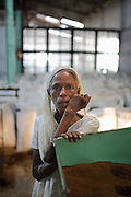 Woman working in a tea factory.