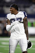Dallas Cowboys defensive end Taco Charlton (97) has a laugh during the NFL week 13 regular season football game against the New Orleans Saints on Thursday, Nov. 29, 2018 in Arlington, Tex. The Cowboys won the game 13-10. (©Paul Anthony Spinelli)
